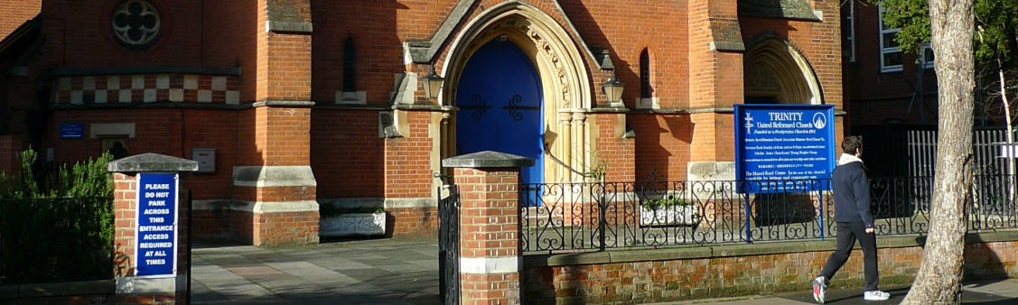 Church front with doors and noticeboard