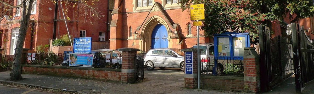 Church front with cars in forecourt weekday