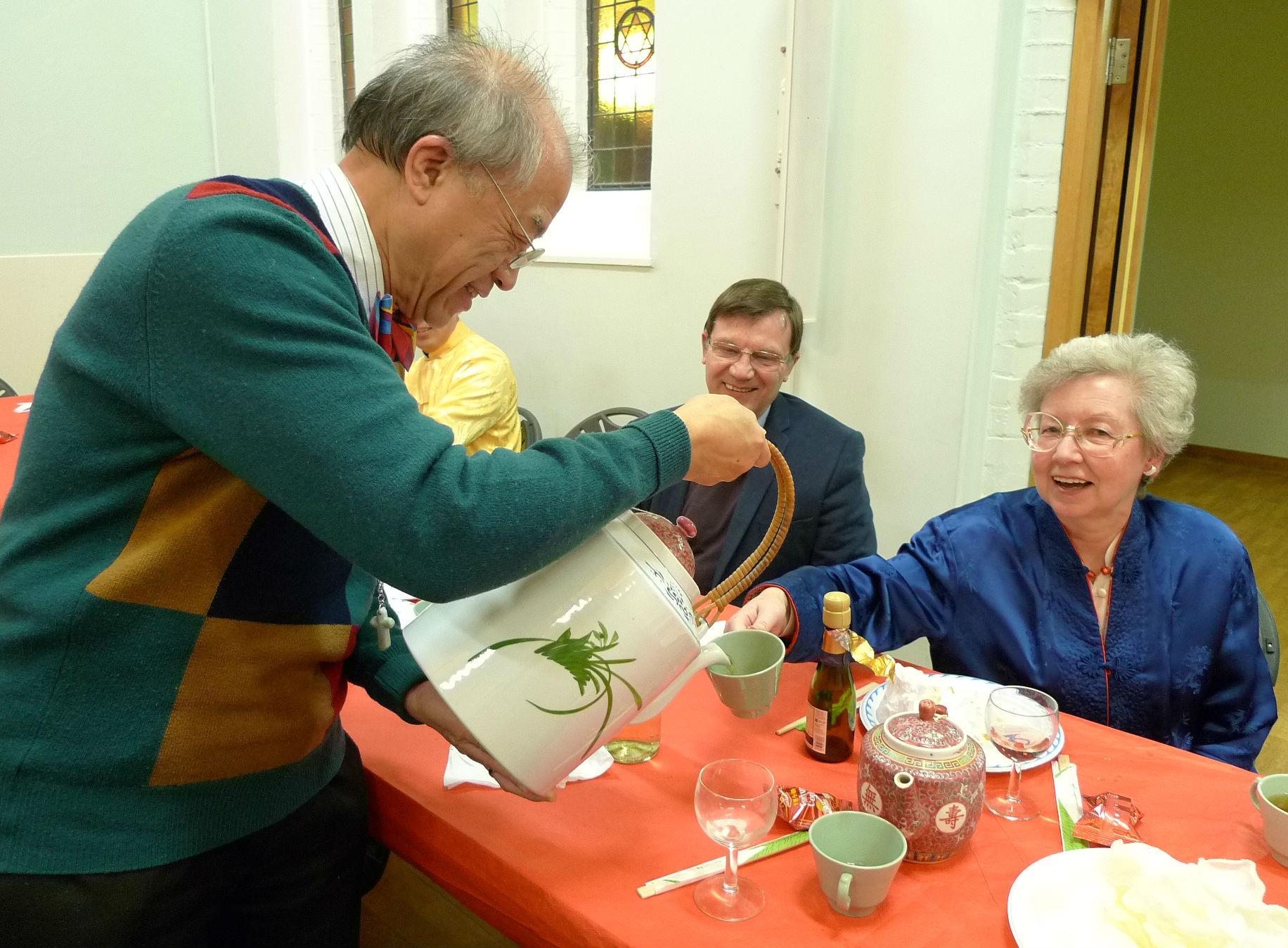 Ernest pouring tea